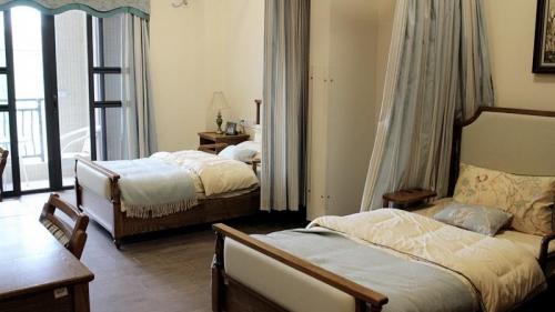 CP长者屋 惠东·十里银滩房间图片